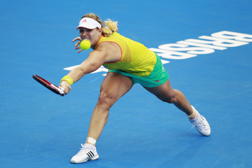 Angelique Kerber of Germany hits a return to Anastasia Pavlyuchenkova of Russia during their women's singles match at the Brisbane International tennis tournament