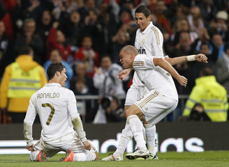 Real Madrid's Ronaldo celebrates after scoring a goal against Sporting Gijon with teammates Pepe and Di Maria during their Spanish First Division soccer match in Madrid