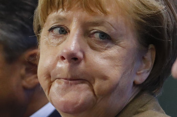 German Chancellor Merkel frowns during a news conference at the Chancellery in Berlin