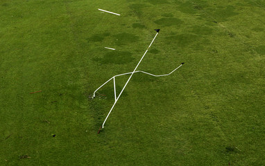 A set of rugby goal posts stand twisted by Cyclone Yasi in the northern Australian town of Tully