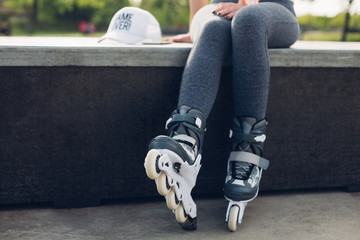 Girl takes a break after skating in skate park