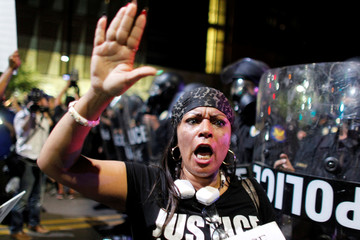 A protester shouts during a demonstration against fatal shootings by the police of two black men across the country, in Phoenix, Arizona
