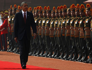 U.S. President Barack Obama inspects an honor guard during an official arrival ceremony at Rashtrapati Bhavan in New Delhi
