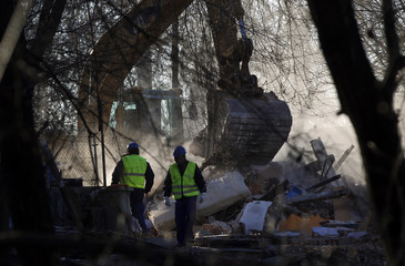 A bulldozer demolishes the home of Agustin Gabarri and Maria Rosario Leston at the Spanish gypsy settlement of Puerta de Hierro outside Madrid