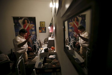 Projectionist Antonio Feliciano spools film onto projection reels at Girasol cinema in Vila Nova de Milfontes
