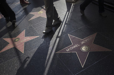 Tourists walk past Michael Jackson's star on Hollywood Boulevard in Los Angeles