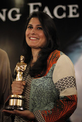 Sharmeen Obaid Chinoy, a Pakistani filmmaker holds her Oscar award trophy as she posses for media after a news conference in Karachi