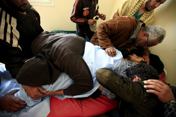 Rebel fighters mourn for their comrade killed on Misrata's western front line