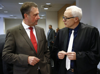 Leader of the German Train Drivers' Union GDL Weselsky and GDL lawyer Gross chat at a local courtroom in Frankfurt