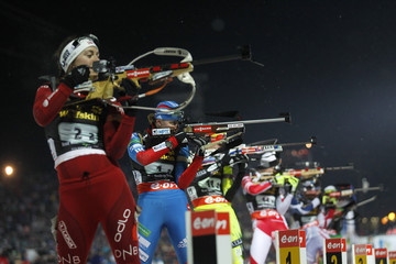 Vilukhina of Russia shoots her rifle next to Solemdal of Norway as they compete in the mixed 2x6+2x7.5 km relay during the IBU World Championships biathlon in Nove Mesto