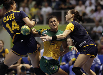 Brazil's Pinheiro is challenged by Spain's Chavez and Barno during their Women's World Handball Championship quarterfinal match in Sao Paulo