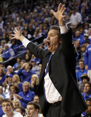 University of Kentucky head coach John Calipari reacts to his team's play against the University of Alabama during the second half of play in their NCAA basketball game at Rupp Arena in Lexington