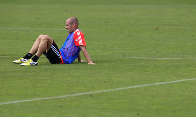 Bayern Munich's Robben takes a break during a training session in Munich