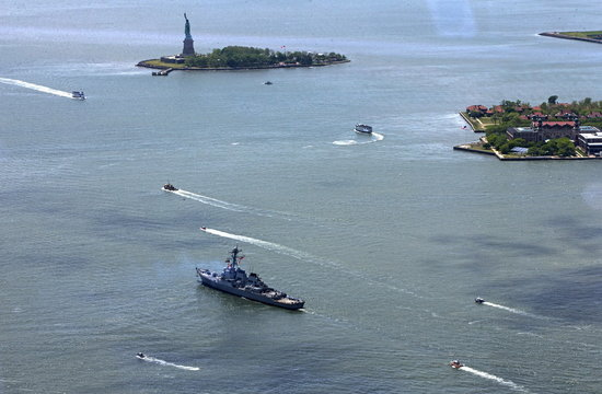A view of New York Harbor and a military ship participating in the Fleet Week parade of ships as seen from the One World Observatory observation deck on the 100th floor of the One World Trade center tower in New York
