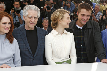 "Director David Cronenberg, cast members John Cusack, Julianne Moore, Mia Wasikowska and Robert Pattinson pose during a photocall for the film ""Maps to the Stars"" in competition at the 67th Cannes Film Festival in Cannes"