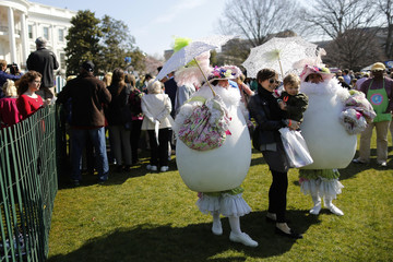 Visitors have their picture taken with volunteers in costume at the annual Easter Egg Roll on the South Lawn of the White House in Washington