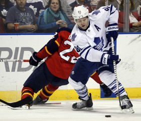 Toronto Maple Leafs Phil Kessel gets past the check of Florida Panthers Matt Bradley in Sunrise