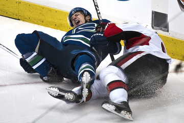 Vancouver Canucks Ballard reacts after his leg twists the wrong way during their NHL hockey game against the Ottawa Senators in Vancouver
