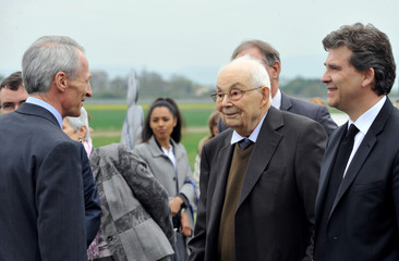 French tyre-making giant Michelin Managing Chairman Jean-Dominique Senard and French Economy and Minister Arnaud Montebourg (R) speak with Francois Michelin, former Michelin chairman, during a visit on the Michelin Ladoux plant in Cebazat