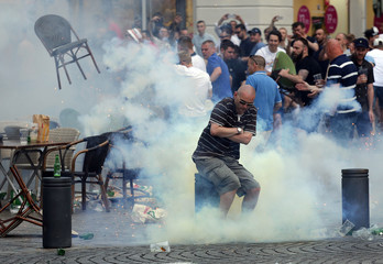 A teargas grenade explodes near an England fan ahead of England's EURO 2016 match in Marseille