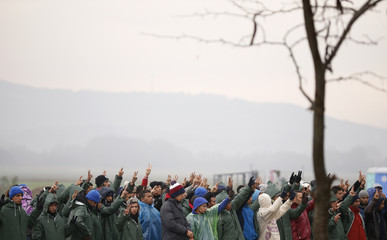 A group of migrants protests at the border with Greece, near Gevgelija