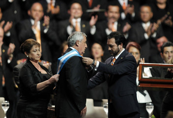 Former general Perez Molina receives presidential sash and appointment in Guatemala City