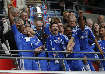 Chelsea's players lift the cup after their FA Cup final soccer match against Liverpool at Wembley Stadium in London
