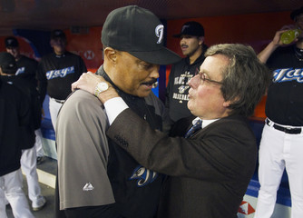 Toronto Blue Jays manager Cito Gaston is hugged by Blue Jays President and CEO Paul Beeston as he is honoured at pre-game ceremonies before the MLB American League baseball game against the New York Yankees in Toronto