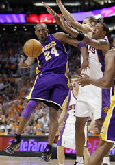 Los Angeles Lakers guard Bryant has to pass off as he is double- teamed by Phoenix Suns during Game 4 of the NBA Western Conference finals in Phoenix
