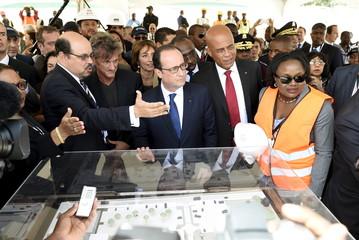 Michael de Landsheer, Sean Penn, Francois Hollande and Michel Martelly attend a presentation of the future Haiti State University hospital, in Port-au-Prince