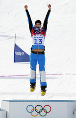 Austria's first-placed Dujmovits celebrates on the podium during the flower ceremony for the women's parallel slalom snowboard event at the 2014 Sochi Winter Olympic Games in Rosa Khutor