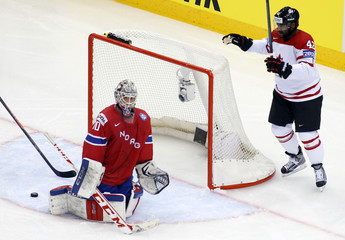 Canada's Ward celebrates his goal as Norway's goalie Soberg reacts during the second period of their men's ice hockey World Championship Group A game at Chizhovka Arena in Minsk