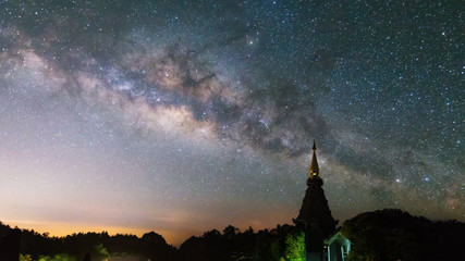 Outstanding high contrast of milky way with star blooming with Silhouette Pagoda Of Doi Inthanon Chiang Mai, Thailand