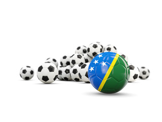 Football with flag of solomon islands isolated on white