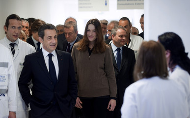 France's President Sarkozy and his wife Carla Bruni-Sarkozy visit a hospital in Frejus