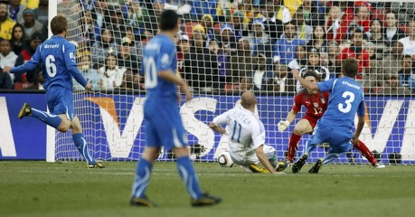 Italy's goalkeeper Federico Marchetti fails to save a goal by Slovakia's Robert Vittek during their 2010 World Cup Group F soccer match at Elis Park stadium in Johannesburg