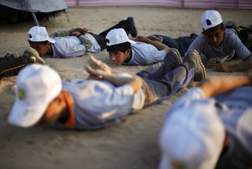 Palestinian children take part in a summer camp organized by Hamas movement at Shati refugee camp in Gaza City