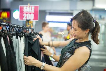 Asian woman choose cloth and dress