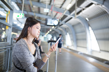 Asian woman using phone for chat and search information