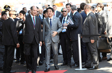 Japanese Prime Minister Shinzo Abe arrives at the G7 Summit expanded session in Taormina