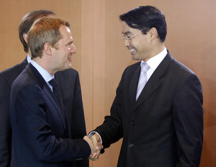 German Health Minister Bahr is welcomed by Economy Minister Roesler beforethe weekly cabinet meeting in Berlin