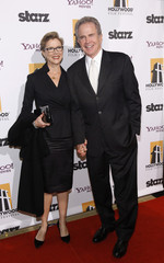 Bening and her husband Beatty pose at the 14th Annual Hollywood Awards Gala in Beverly Hills