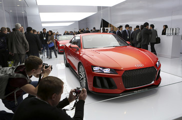 Conference attendees take photographs of Audi Sport Quattro laserlight concept car, featuring laser headlights, at the annual Consumer Electronics Show in Las Vegas