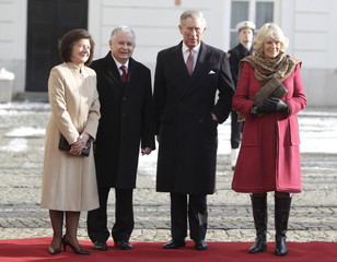 Britain's Prince Charles and his wife Camilla, Duchess of Cornwall meet Poland's President Kaczynski and his wife Maria in Warsaw