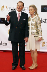 British actor Moore and his wife pose during the opening ceremony of the 52nd Monte-Carlo Television Festival in Monaco
