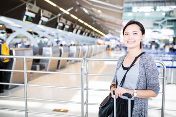 Asian woman traveller walking