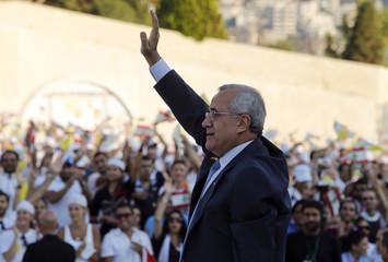 Lebanon's President Michel Suleiman waves before Pope Benedict XVI meets youths at Bkerke in Harissa, near Beirut