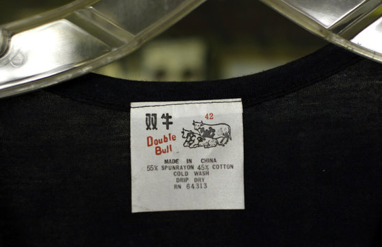 A shirt displays a 'Made in China' label in Los Angeles