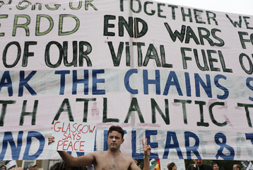Demonstrators protest against the NATO summit being held at the Celtic Manor resort, near Newport