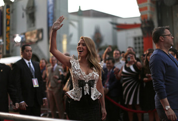 "Cast member Johansson waves at fans at the premiere of ""Captain America: The Winter Soldier"" at El Capitan theatre in Hollywood"